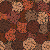Circular, tribal pattern in brown tones with motifs of an African tribes Surma and Mursi Stock Photo