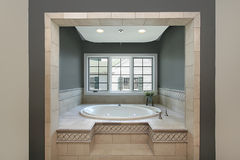 Circular tub in master bath Royalty Free Stock Photo