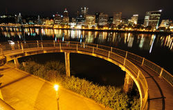 Circular walkway and city view in night time Stock Photography