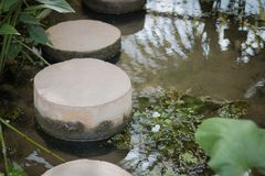 Circular walkways. Are constructed from cement to cross the water stock photography