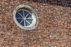 Circular Window in brick wall. Circular Window in old victorian building brick wall royalty free stock photography