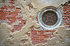 Circular window in an old wall Stock Images