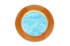 Circular window overlooking the pool water Stock Photos