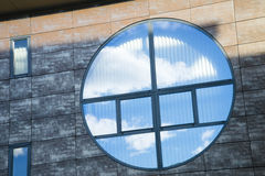 Circular window reflecting a blue sky Royalty Free Stock Photos