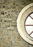 The circular window. On a stone wall stock photography