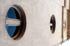 The circular windows with blue glass, modern contemporary archit Stock Photography