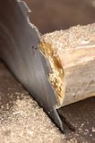 A circular wood saw and wood Stock Images