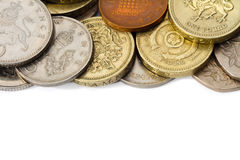 Circulated British Coins with White Copy Space. An edge of a pile of circulated British coins with white copy space at the bottom Royalty Free Stock Image
