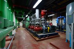 Circulating pump, chiller water pump in the basement. A circulator pump is a specific type of pump used to circulate gases, liquids, or slurries in a closed Stock Images