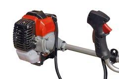 Circulez en voiture le trimmer de la tondeuse à gazon pour l'herbe comme la machine de jardin sur le blanc photo stock