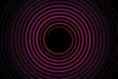 Circunde o círculo fresco cor-de-rosa brilhante dinâmico na obscuridade Fotos de Stock Royalty Free