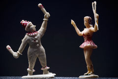 Circus. Vintage circus figurines - juggler and a lion tamer - against dark background Stock Photo