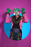 Circus actor in zombie suit posing on bright color Stock Photos