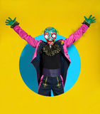 Circus actor in zombie suit posing on bright color Stock Image