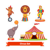 Circus animals, bear, lion, elephant, clown. Circus animals, bear on monocycle in party hat, lion, elephant holding ball on a trunk,    clown and tent with wagon Royalty Free Stock Photography