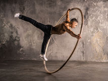 Circus artist in aCyr Wheel. Strong circus performer spinning a cyr wheel Royalty Free Stock Image