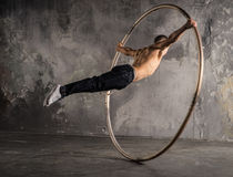 Circus artist in aCyr Wheel. Strong circus performer spinning a cyr wheel Royalty Free Stock Photos