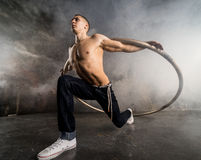 Circus artist in aCyr Wheel. Strong circus performer spinning a cyr wheel Royalty Free Stock Photography
