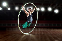 Circus artist in a Cyr Wheel Royalty Free Stock Photography