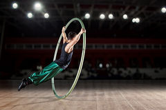 Circus artist in a Cyr Wheel Stock Image