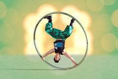Circus artist in a Cyr Wheel Stock Images