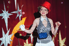 Circus artist woman magician in the glow of spotlight Royalty Free Stock Images