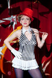 Circus artist woman magician in the glow of spotlight Stock Images