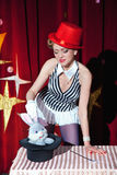 Circus artist woman magician shows magic trick Royalty Free Stock Image