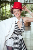 Circus artist woman in red hat Stock Image