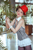 Circus artist woman in red hat Royalty Free Stock Photos