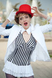 Circus artist woman in red hat with a surprised expression on he Royalty Free Stock Photos