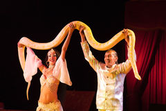 Circus artists with a constrictor snake  Royalty Free Stock Photography