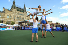 Circus artists make difficult tricks on the court Stock Image
