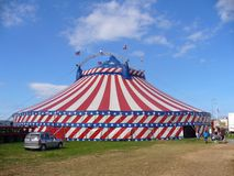 Circus Big Top. A general view of a circus big top tent errected in a field. It is decorated in the stars and strips of the American flag Stock Photography