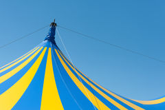 Circus big top. Large yellow and blue circus big top canvas against a clear blue sky Stock Photo