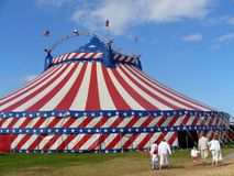 Circus Big Top Tent. A general view of a circus big top tent errected in a field. It is decorated in the stars and strips of the American flag Stock Images