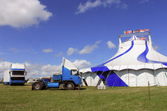 Circus big top tent. And trucks in field Stock Photos
