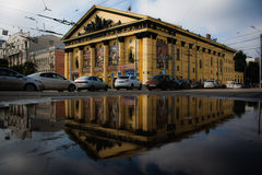 The circus building in Rostov-on-don. Yellow circus building in Rostov-on-don in the reflection Royalty Free Stock Photography