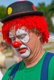 Circus Clown. A close up photo of a clown. It is an outdoor image taken on a sunny day Royalty Free Stock Image