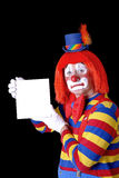 Circus Clown. Close-up of clown holding blank sign Stock Photography