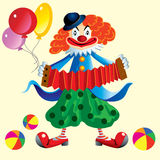 Circus clown with an accordion and balloons. Brightly painted circus clown plays the harmonica Royalty Free Stock Photos