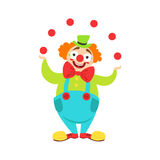 Circus Clown Artist In Classic Outfit With Red Nose And Make Up Performing Juggling Stunt For The Circus Show Royalty Free Stock Photography