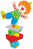 Circus clown equilibrist. Vector clip-art of a funny circus clown balancing on a few objects Stock Photo
