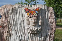 Circus clown image, carved in stone stock illustration