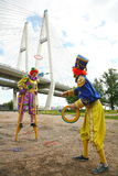 Circus clowns animators throw colored rings. Image with two clowns posing a public place. circus clowns animators throw colored rings on the background of the Stock Images