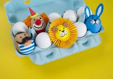 Circus.The concept of Easter with cute and cheerful handmade eggs. Painted Easter eggs in different moods and facial expression The concept of Easter with cute Stock Photos