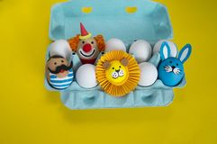 Circus.The concept of Easter with cute and cheerful handmade eggs. Painted Easter eggs in different moods and facial expression The concept of Easter with cute Stock Images