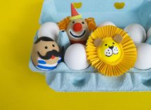 Circus.The concept of Easter with cute and cheerful handmade eggs. Painted Easter eggs in different moods and facial expression The concept of Easter with cute Royalty Free Stock Photography