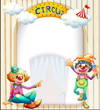 A circus entrance with a male and a female clown Stock Photo