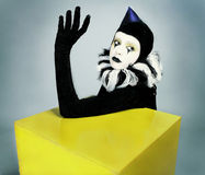 Circus Fashion Mime Posing Near A Yellow Square Stock Image